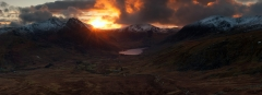 Panoramic landscape photography/ Last light over Tryfan Glyders Snowdonia North Wales mountains sunset panorama.