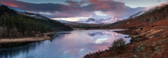 Panoramic landscape photography/Llynau Mymbyr and Snowdon Horseshoe in the background at Winter sunrise in Snowdonia North Wales